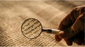 Someone reading Cyrillic script on a page through a magnifying glass