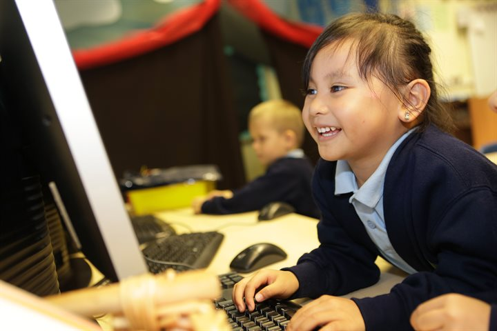 Child using a computer in school