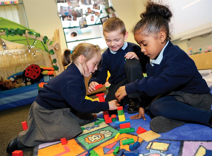 School children using building blocks