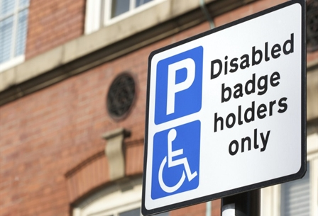 "A picture of a ""Disabled badge holders only"" sign."