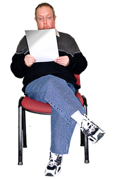 Man sitting down reading a document