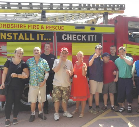 Group with fire engine