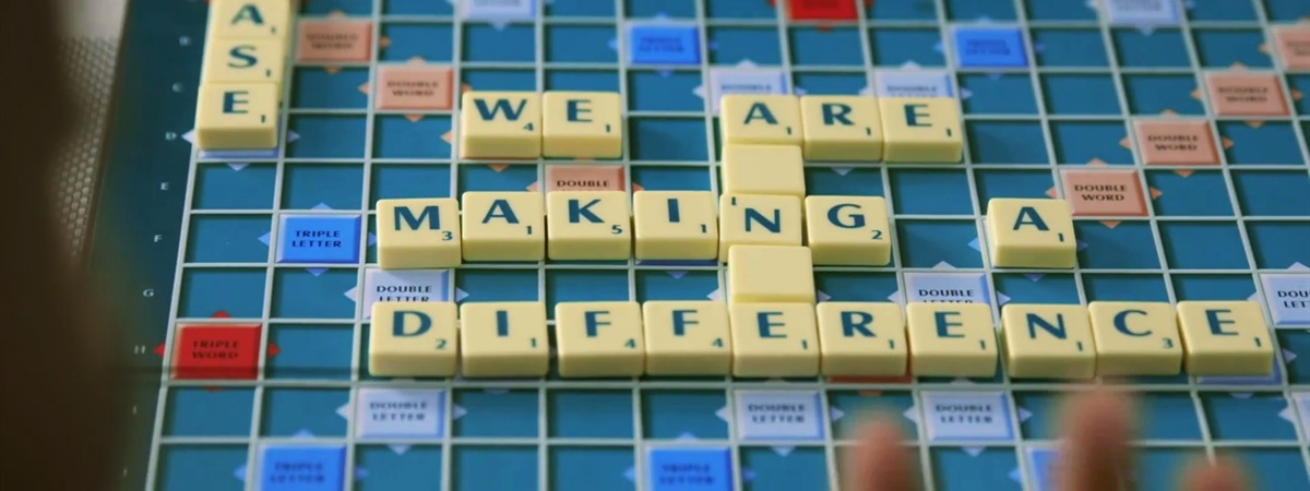 'We are making a difference' written in Scrabble letters.