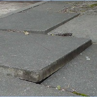Trip hazard - raised paving slab