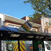 bus stop sign damaged