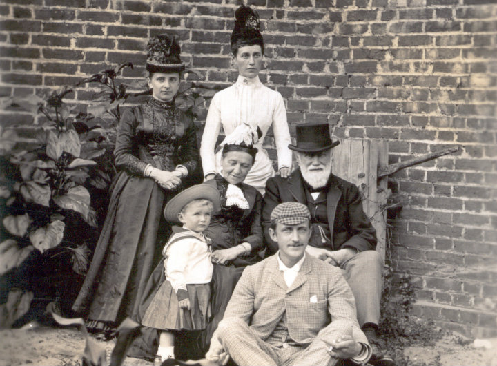 An old photograph of a family at a funeral.