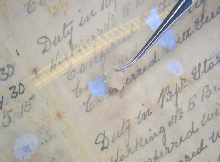 A picture of an old document being restored