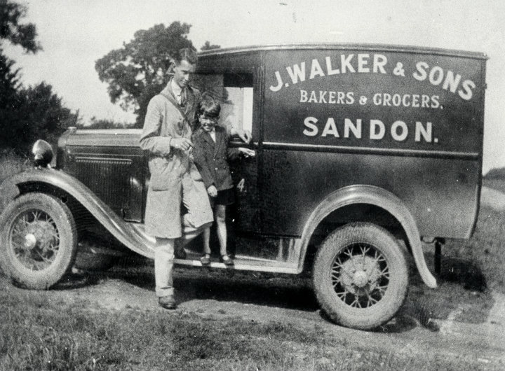 A greengrocer standing by his van in 1930.