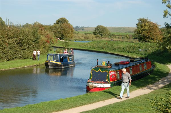 A man walking along the Grand Union Canal