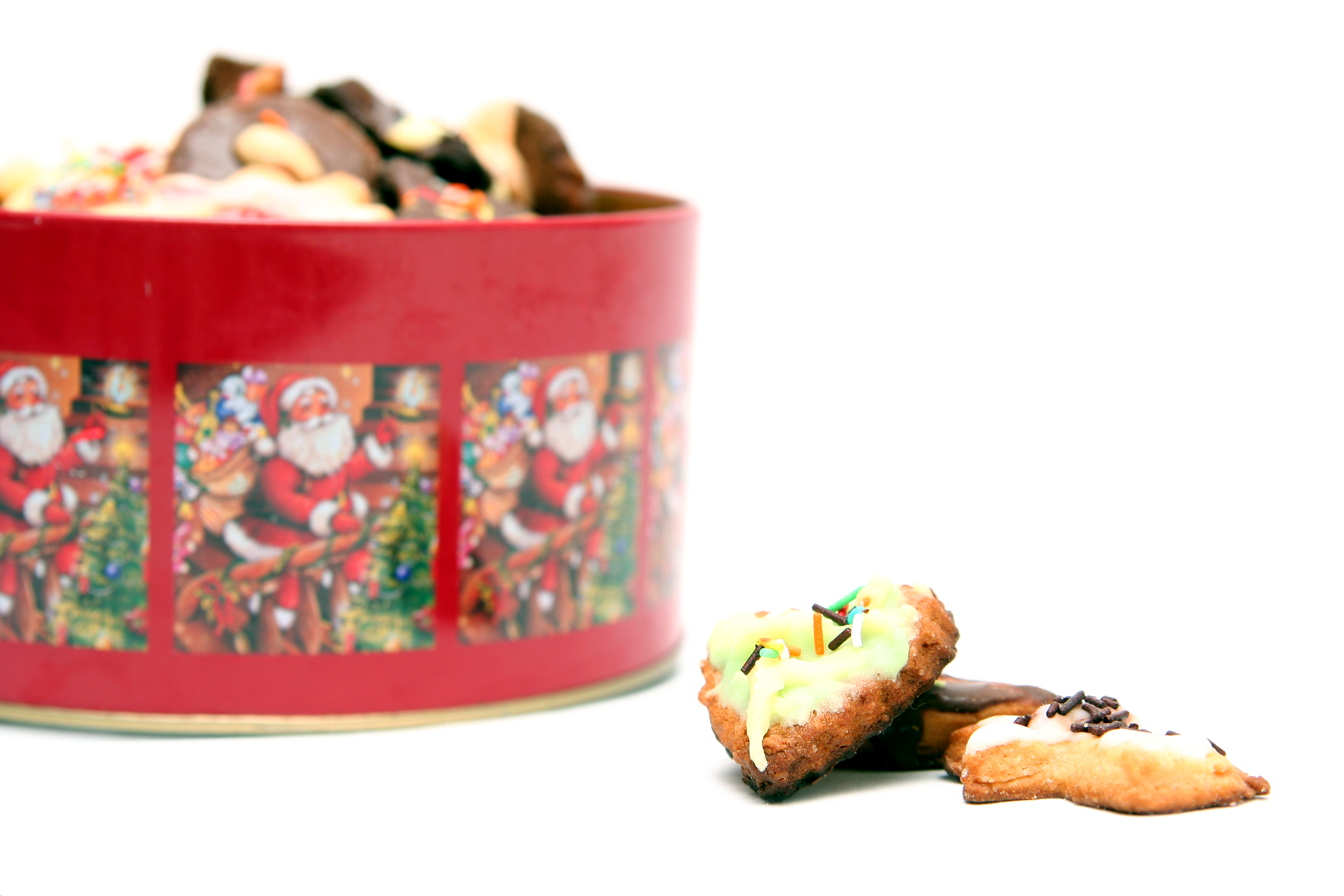 A Christmas themed tin of cookies.