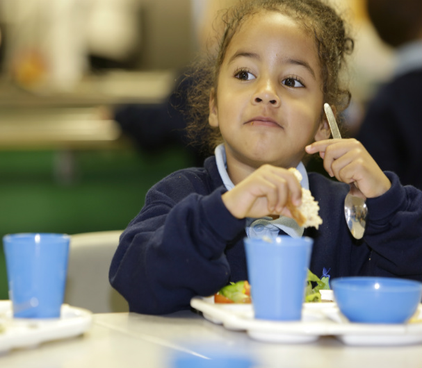 A child eating a healthy school meal