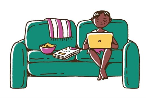 Parent using a laptop on their couch